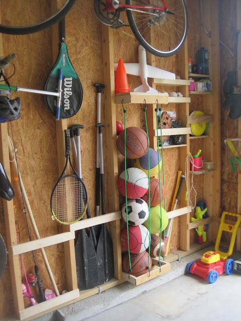 30+ Creative Ways to Organize Your Garage --> Keep sports balls easily organized with bungee cords and save space