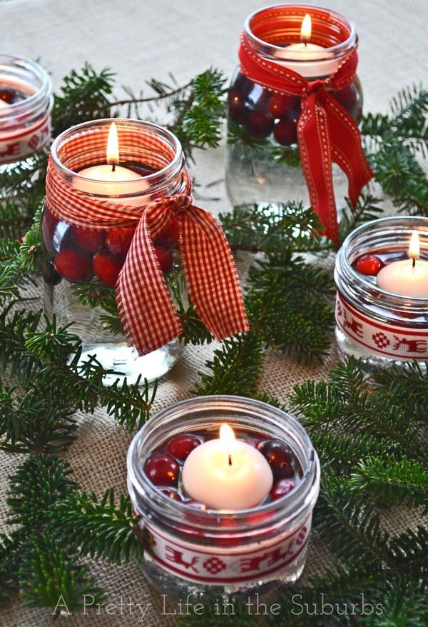 40+ Creative DIY Holiday Candles Projects --> Cranberry Floating Candle Jars