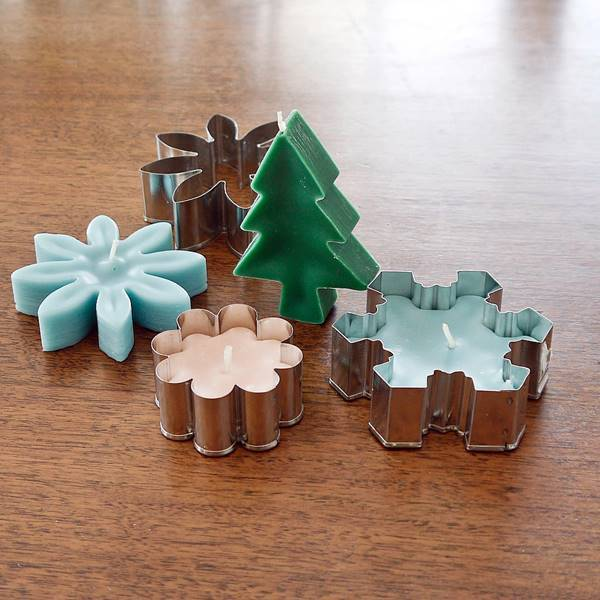 40+ Creative DIY Holiday Candles Projects --> DIY Charming Cookie-Cutter Candles
