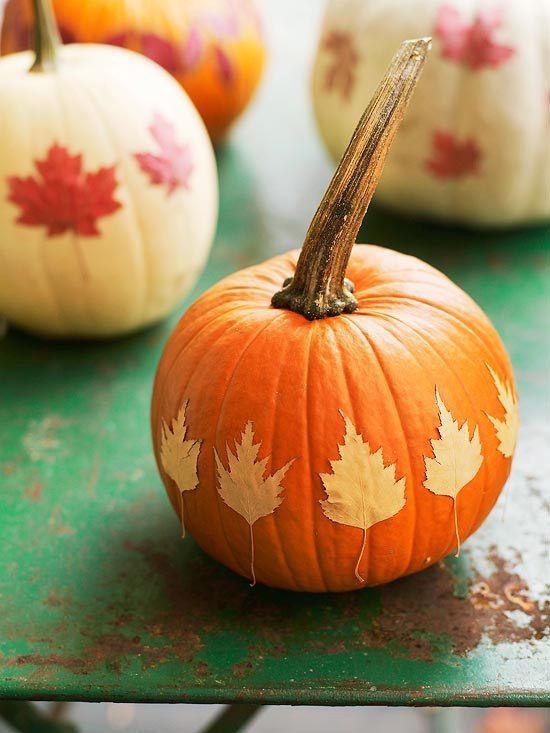 40+ Creative DIY Craft Projects with Fall Leaves --> Decorated Pumpkin Centerpiece with Decoupaged Leaves