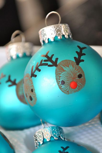 40 creative handprint and footprint crafts for christmas thumbprint reindeer christmas ornaments