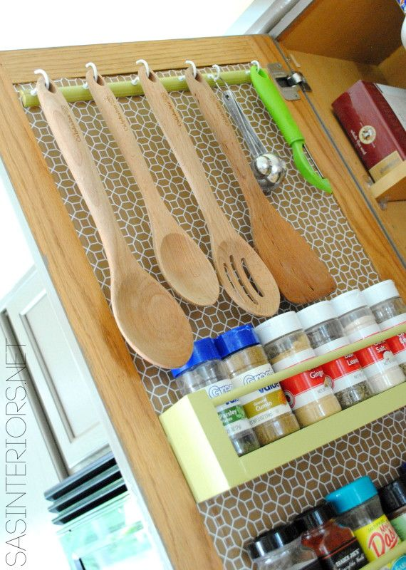 40+ Organization and Storage Hacks for Small Kitchens --> Make use of the inside of your cabinet doors to store spices and kitchen utensils
