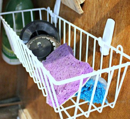 40+ Organization and Storage Hacks for Small Kitchens --> Take advantage of the vertical space under the sink with two Command hooks and a small plastic basket