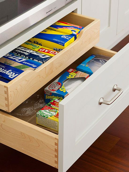 40+ Organization and Storage Hacks for Small Kitchens --> Divide the space of a deep drawer with a sliding insert