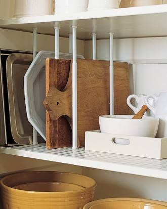 40+ Organization and Storage Hacks for Small Kitchens --> Use tension rods as pantry dividers for easy and space-saving storage