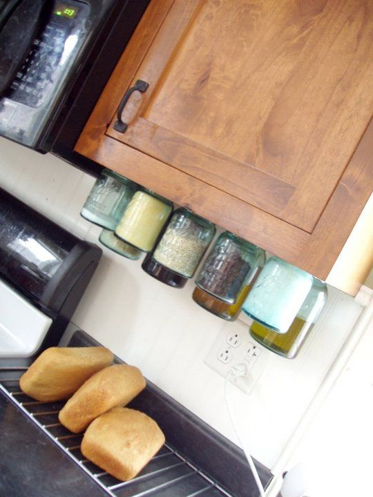 40+ Organization and Storage Hacks for Small Kitchens --> DIY mason jar organizers to make use of the space under your cabinets