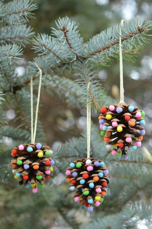 40+ Creative Pinecone Crafts for Your Holiday Decorations --> Pom Poms and Pinecones Christmas Ornaments