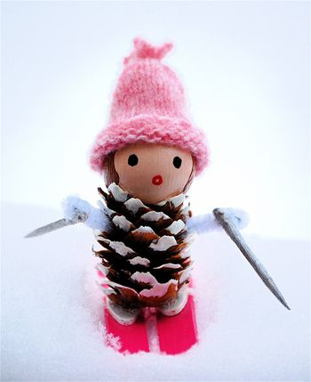 40+ Creative Pinecone Crafts for Your Holiday Decorations --> Little Miss Pine Cones Go Skiing