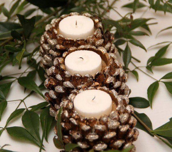 40+ Creative Pinecone Crafts for Your Holiday Decorations --> Pinecone Candle Holders