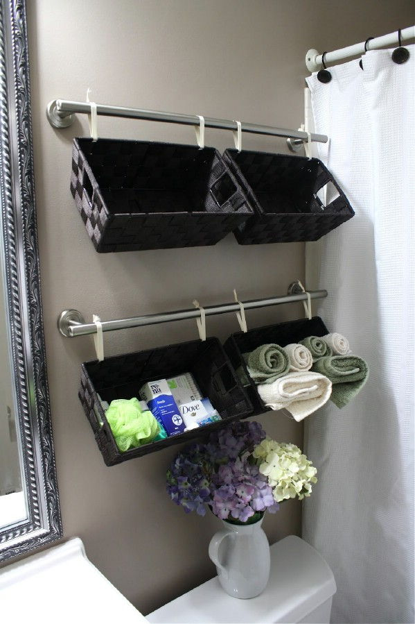 40+ Brilliant DIY Storage and Organization Hacks for Small Bathrooms --> Install towel bars over the toilet to hang baskets for extra storage space