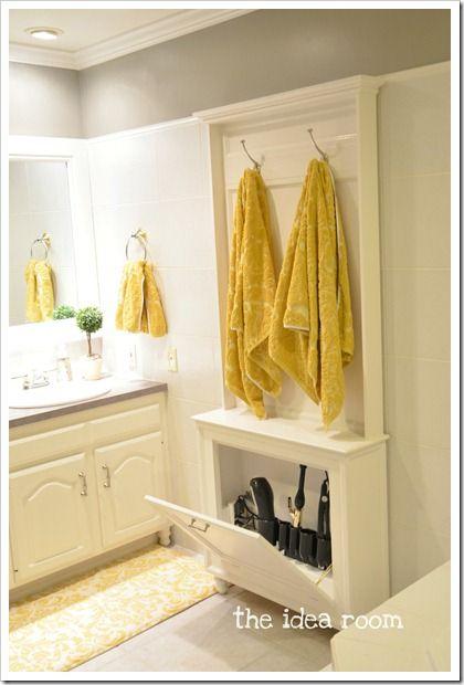40+ Brilliant DIY Storage and Organization Hacks for Small Bathrooms --> DIY hair tool storage cabinet