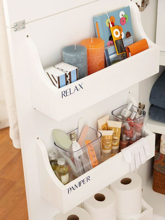 40+ Brilliant DIY Storage and Organization Hacks for Small Bathrooms --> Attach caddies to the back of a cabinet door to add storage space