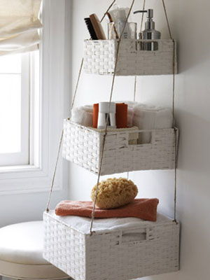 40+ Brilliant DIY Storage and Organization Hacks for Small Bathrooms --> Create storage space by hanging a series of baskets from the ceiling
