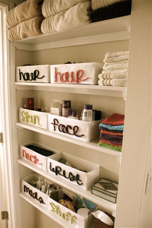 40+ Brilliant DIY Storage and Organization Hacks for Small Bathrooms --> Organize bathroom closet with canvas organizers and felt labels