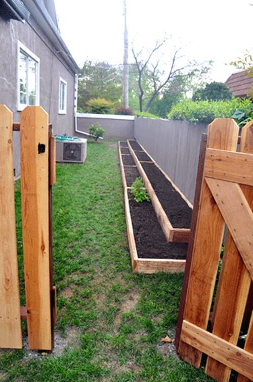 30+ Creative DIY Raised Garden Bed Ideas And Projects --> Build tiered garden beds along the fence