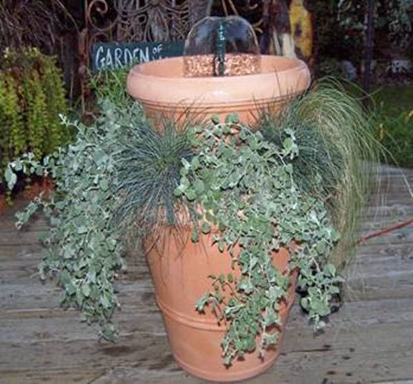 40+ Creative DIY Water Features For Your Garden --> Convert Two Pots into a Garden Water Feature with Two Ups-A-Daisy Planter Inserts