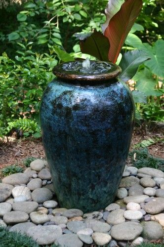 40+ Creative DIY Water Features For Your Garden --> Water Garden in Large Glazed Pot