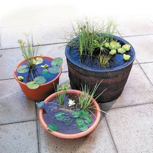 18 great diy water features for your garden style motivation for Recirculating water feature