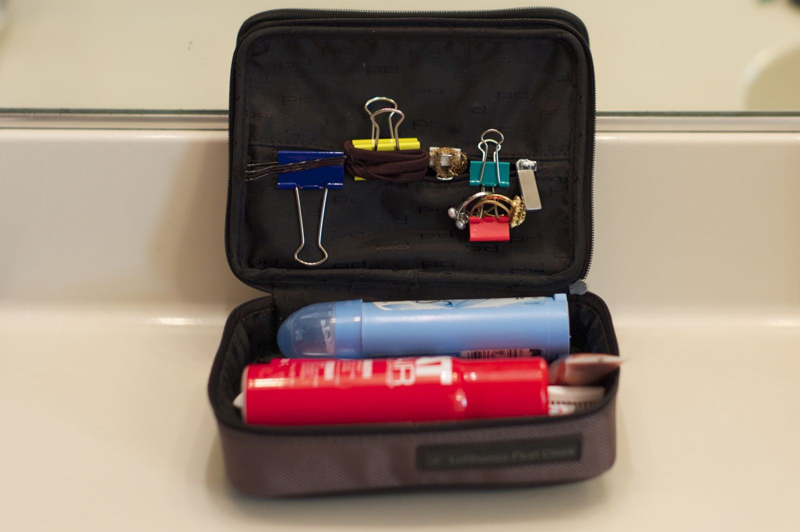 Attach binder clips to the inside of a travel bag to organize your accessories while travelling