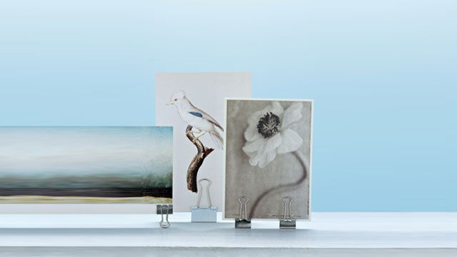 Display your favorite photos without frames by using binder clips to hold up the photos