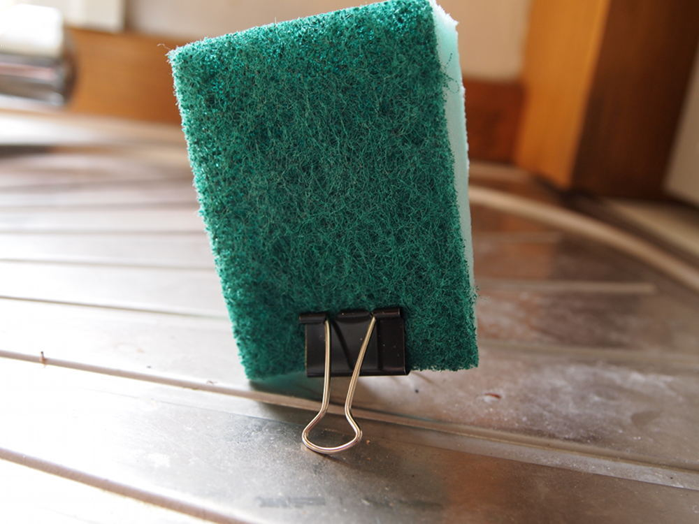 Keep sponge dry and free from mildew by using a binder clip as a stand