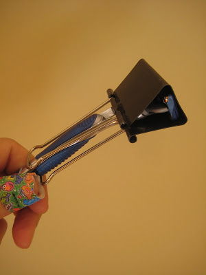 Use a binder clip as a razor cover to protect from unexpected cuts